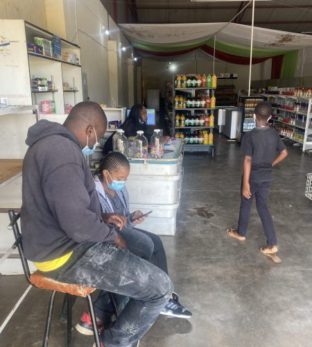 Sithokozile collecting data from one of the corner shops in the project